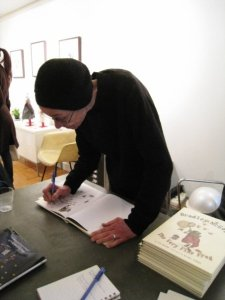 Rachel Berman signing a copy of the book