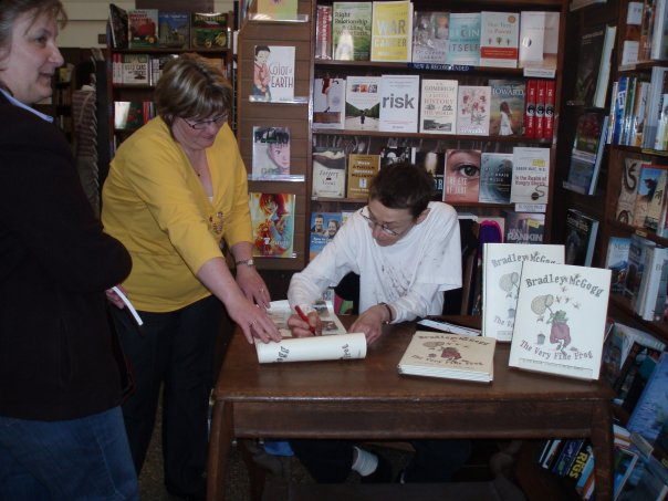 Rachel Berman signing books and posters at Munro's Books